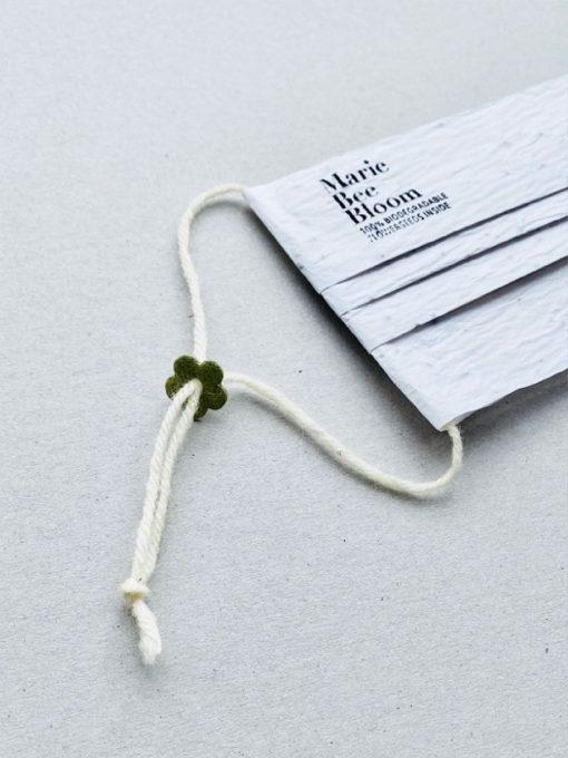 marie bee bloom biologisch afbreekbaar mondkapje met zaadjes wasbare luiers billenboetiek Utrecht touwtje van wol